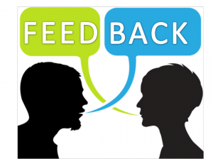 "Silhouette of two head with speech bubbles, saying ""Feed"" ""Back"", suggesting a dialogue."