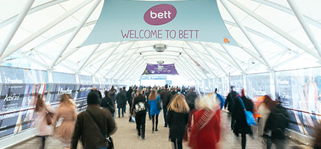 Welcome to 'BETT' sign with lots of people entering the show.