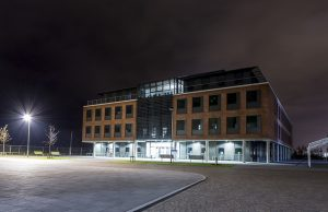 A night time photograph of the School of Management building at the Bay Campus Swansea University