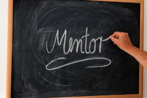 The word mentor written on a chalkboard