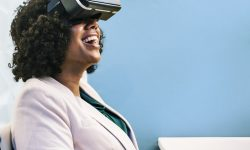 woman smiling wearing a VR headset