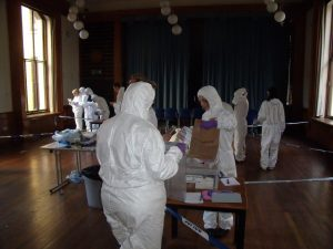 Students taking part in Experiential Learning in a simulated crime scene