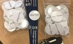 Swansea University Pronoun Badges on a Swansea Uni lanyard