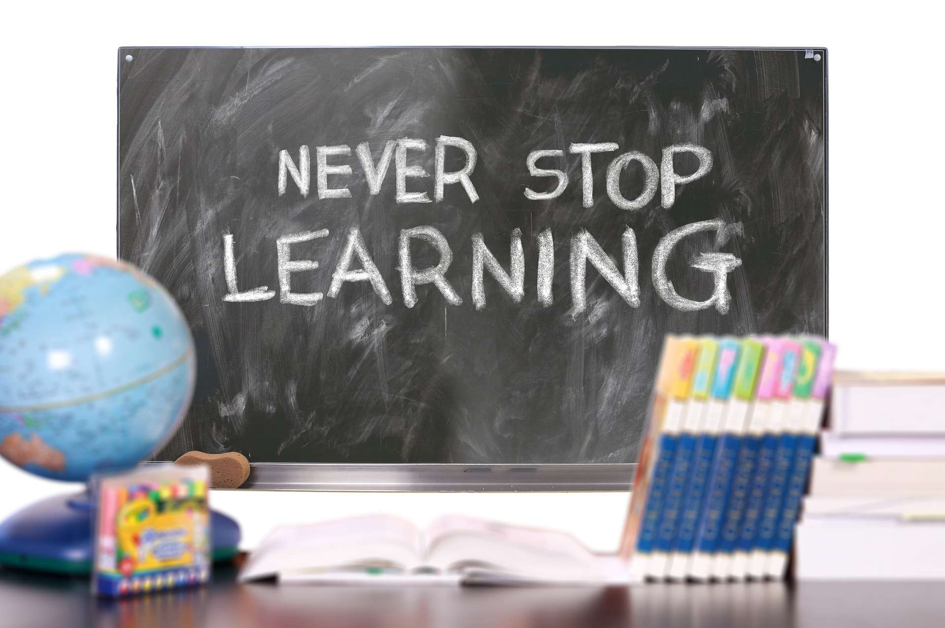 "Chalkboard with phrase ""Never Stop Learning"""