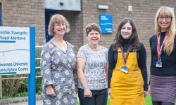 Transcription centre staff standing outside the centre
