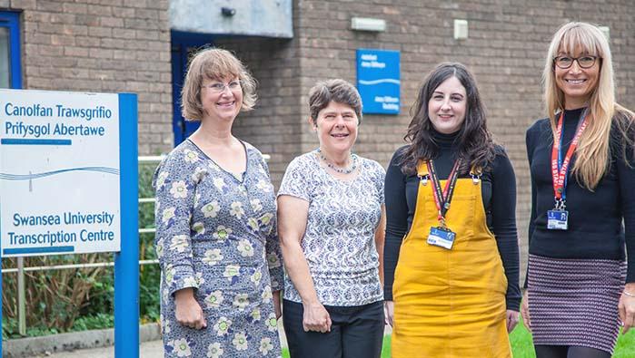 Transcription centre staff standing outside the centre