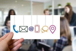 Image of a small card with symbols for phone,email, cellphone, chat and other forms of communication