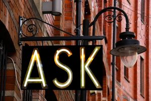 A shop sign spelling out the word 'Ask'