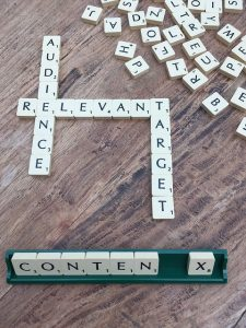 Image of scrabble tiles spelling Audience, Relevant, Target and a potential word of Content